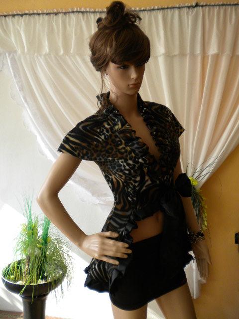 Елегантно и стилно дамско елече в леопардов мотив с черна панделка и къдри